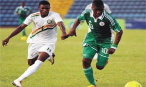 Flying Eagles Striker, Kelechi Iheancho in hot pursuit by an opponent during recent match for Nigeria