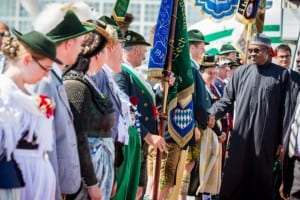 President Muhammadu Buhari (right), inspecting a guard of honour on his arrival in Germany, yesterday