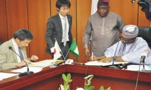 Minister of National Planning, Dr Abubakar Sulaiman (right), and representative of Japanese Ambassador to Nigeria, Mr Masaya Otsuka (left), signing exchange notes for provision of Japanese disaster reduction equipment. in Abuja, recently. Photo: NAN