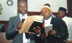 The new Speaker of the Rivers State House of Assembly, Rt Hon Ikuinyi-Owaji Ibani (left), taking his oath of office, at the Assembly complex in Port Harcourt on Monday