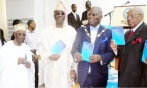 "L-R: Founder, Chartered Institute of Bankers of Nigeria, (CIBN), Alhaji Oladimeji Otiti, Oba of Lagos, Obarilwan Akiolu, President, CIBN, Dr Sina Aina and Chairman, First City Monument Bank, Otunba Micheal Balogun, during the unveiling of a book titled ""The Economy of Financial Inclusion In Nigeria"" written by Dr Aina in Lagos."