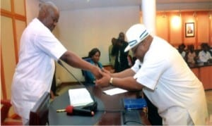 Governor Nyesom Wike of Rivers State (left), congratulating the new Secretary to the State Government, Chief Kenneth Kobani, after his swearing-in at Government House, Port Harcourt, last Friday.    Photo: Chris Monyanaga