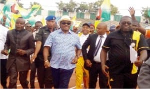 Governor Willie Obiano of Anambra State (middle), Rommy Ezeonuwuka (left) and other officials, at the inauguration of 8-Lane Olympic Standard Tartan Tracks at Rojenny Stadium in Oba, last Thursdays