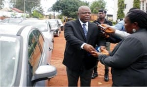 Chief  Judge of  Anambra State, Justice Peter Umeadi (Left),  presenting a car key to the Chief  Registrar,  State Judiciary, Mrs Doris Ezeani, symbolising the presentation of  cars to 20  newly appointed magistrates and two other staff of the State judiciary in Awka on Monday