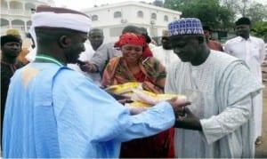 Senator Abdul-Aziz Nyako of Adamawa Central Senatorial District (left), distributing improved maize seedlings to farmers in  Yola, recently.   Photo: NAN