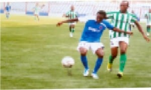Sharks player (left) being shadowed by an apponent in a Glo Premier League game