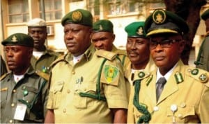 L-R Chief  Superintendent of Prisons, Dr Chijioke Onwe; Controller of Prisons, Enugu Command, Mr Ikechukwu Uchenwa and Deputy Controller of  Prisons, Mr Fred Akam, at a reception for newly promoted officers of Enugu Prisons Command in Enugu last Sunday.