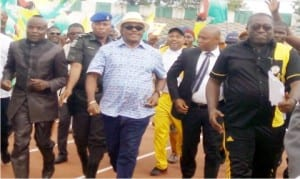 Governor Willie Obiano of Anambra State (middle), and others jogging   after the inauguration of 8-lane Olympic Standard Tartan Tracks at Rojenny Stadium in  Oba, recently.    Photo: NAN