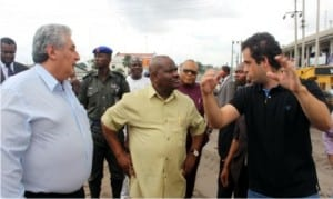 Rivers State Governor, Chief Nyesom Wike (middle), listening to Eyas Nassar (right), during inspection tour at Trans-Amadi Slaughter Road, while Engr. Igor Zavodic watches.