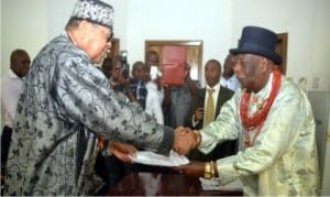 Fromer Chairman, Rivers State Council of Traditional Rulers, King Godwin N.K Giniwa (right), handing over to the new Chairman of the council, King Dandeson Douglas-Jaja, Amanyanabo of Opobo, during the hand  over ceremony in Port Harcourt, yesterday