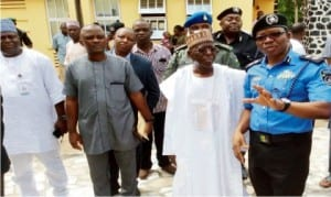 Kogi State Police Commissioner, Mr Adeyemi Ogunjemilusi (right), explaining a point to Governor Idris Wada (2nd-right), during his visit to the Police Headquarters in Lokoja last Monday. With them are the Chief of Staff to the Governor, Alhaji Nasiru Yunusa (left) and the Personal Assistant, Mr Unekwu Sule.