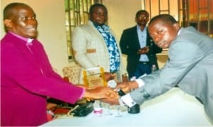 Bishop, Niger Delta Diocese, Rt Rev Ralph Ebirien (left) receiving the award from WASU representative while others look on.