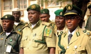 From L-R: Cheif Superintendent of Prisons, Dr Chijioke Onwe; Controller of Prisons, Enugu Command, Mr Ikechukwu Uchenwa and Deputy Controller of Prisons, Mr Fred Akam, at a reception for newly promoted officers of Enugu Prisons Command in Enugu, recently.               Photo: NAN