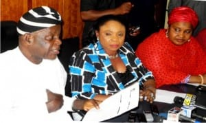 L-R: Chairman, Police Service Commission (PSC), Sir Mike Okiro, Commissioner for Media, South-East Zone, Dame Comfort Obi and Commisioner for Women Affairs, Hajia Aisha Tukur, at a news conference on the alleged N275 million Election Monitoring Fund's fraud rocking the PSC, in Abuja, recently.