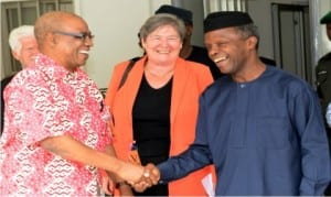 Vice President, Prof. Yemi Osinbajo (right), in a handshake with the Chairman, Nigerian Extractive Industries Transparency International (NEITI) Board, Mr Ledun Mitee, during a courtesy visit to the Vice President  in Abuja .  With him is the Chairman of Etractive Industries Transparency International (EITI) Board, Clare Short
