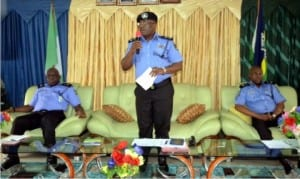 Rivers State Commissioner of Police, Mr Chris Okey Ezike (middle), addressing pressmen in Port Harcourt during a press briefing. With him are Mr H. Agbonlahor (left) and Mr F. Odesanya
