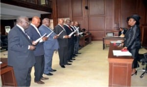 Acting Chief Judge of Rivers State, Hon. Justice Daisy Okocha (right) administring the Oath of Office for newly appointed members of Notary Public at the High Court complex, Port Harcourt, ercently.