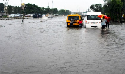 Flooded Ikorodu road in Lagos due to heavy a down pour, recently.