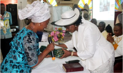 Rivers State Deputy Governor, Dr Ipalibo Banigo (right), receiving a souvenir from the wife of the Bishop of the Niger Delta Diocese, Mrs Victoria R. Ebirien, during a lecture to mark the 5th anniversary Enthronement service of the latter's husband at St Peters's Anglican Church, Port Harcourt