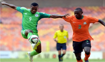 Dream Team VI's Peter Onyekachi (9) trying to short home in a previous match. The team has promised to delve against Congo on Sunday.