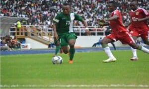 Dream Team VI's Godwin Saviour (13) meandering past Congo players Sunday at the Adokiye Amesimaka Stadium, Port Harcourt.