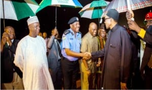 Inspector-General of Police, Mr Solomon Arase (3rd left) and other government officials, welcoming President Muhammadu Buhari at the Presidential Wing of Nnamdi Azikiwe International Airport in Abuja, yesterday  after the president's 3-day trip to Washington DC.