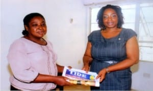 Director of Administration, Rivers State Newspaper Corporation (RSNC), Mrs Emi Jameson (left), presenting  copies of  The Tide newspaper to the President, Rotary Club of Port Harcourt, Rtn Anne Anyaka,when members of the club  paid a courtesy visit to the corporation in Port Harcourt on Wednesday         Photo: Egberi .A. Sampson