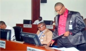 Leader of the Rivers State House of Assembly, Hon. Martin Amaewhule (right), presenting to the House an Amendment Law on Kidnapping in Rivers State at the sitting of the House in Port Harcourt, recently.                     Photo: Chris Monyanaga