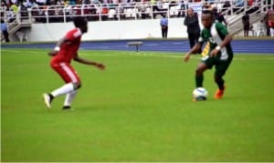 A Nigerian player (right) trying to dribble past a Congolese oppoenent when both teams clashed in Port Harcourt on Sunday.