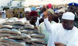 Governor Aminu Tambuwal (right), during the sale of fertilizer in Rabah Local Government Area of Sokoto State, yesterday