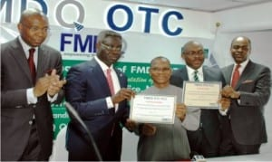 L-R: Former Chairman, Board of Directors, Financial Market Dealers Quotation (fmdq) Otc Plc, Aigboje Aig-Imoukhuede, Group Managing Director, Uba Group,Phillip Oduoza, Director-General, Debt Management Office, Dr Abraham Nwankwo, Managing Director of fmdq, Bola Onadele Koko and Chief Executive Officer, Chapel Hill Advisory Partners Ltd, Bolaji Balogun, at the bond listing of the Federal Government on fmdq platform in Lagos, recently.