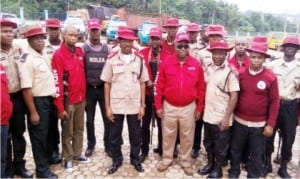 Sector Commander Frsc, Anambra State, Mr Sunday Ajayi (middle), Commander, Ndlea  in Anambra State, Mr Sule Momodu (3rd right) addressing officers of the Joint Team at the Frsc State Headquarters in Awka yesterday