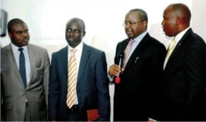 L-R: Deputy Director, Securities and Exchange Commission (SEC), Alhaji Hassan Suleiman, Executive Director, Business Process, Nigeria Inter-Bank Settlement System (NIBSS) Mr. Niyi Ajao, Director- General, Securities and Exchange Commission, Mr Mounir Gwarzo and Head, (NIBSS),  Mr. Samuel Oluyemi, at the Launch of the e-dividend Portal in Lagos on Wednesday