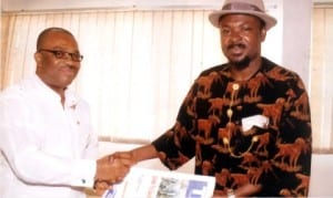 General Manager, Rivers State Newspaper Corporation, Mr Celestine Ogolo (left), presenting copies of The Tide  to Federal Commissioner, Public Complaints Commission, Rivers State, Dr Alphaus Paul-Worika, during a facility visit to the corporation, on Friday.