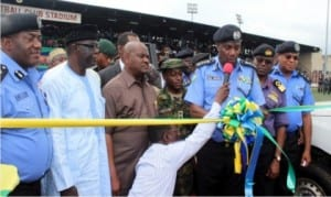 Rivers State Governor, Chief Nyesom  Wike (3rd left), watching as the Inspector General of Police, Mr. Solomon Arase (3rd  right), commissioned  64 patrol utility security vans for the police and other security agencies in Rivers State, in Port Harcourt, yesterday