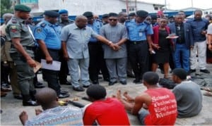 Governor Nyesom Wike of Rivers  State (3rd leftl), Commissioner of Police, Rivers Command, Mr Chris Ezike (2nd left), and National Chairman of PDP,  Prince  Uche Secondus (4th left), during the Parade of  Suspects  by the Commissioner of Police in Port Harcourt  recently