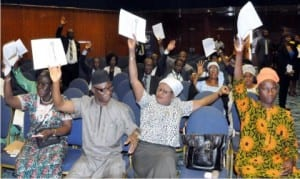 Shareholders voting at the extraordinary general meeting of Stanbic IBTC in Abuja, yesterday.