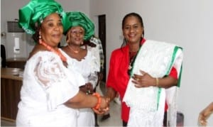 Rivers State Deputy Governor, Dr Ipalibo Banigo (right), being decorated as Patron by the President, Market Women and Men Association of Nigeria, Rivers State chapter, Mrs Charity Abonyo (left), while the state Secretary, Mrs Helen Iyalla watches, during their courtesy visit to Government House, Port Harcourt, yesterday.