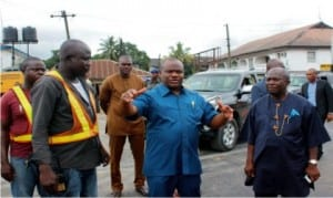Rivers State Governor, Chief Nyesom Wike (middle), discussing with Engr. Rowland Otabah (left), during an inspection of Evo road project, while Chief of Staff, Government House, Engr. Emeka Woke (right) watches in Port Harcourt recently