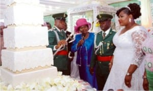 Rivers State Deputy Governor, Dr. Ipalibo Harry- Banigo (2nd left),  supervising the cutting of wedding cake of the newly wedded couple, Lt and Mrs. Bonaventure Obonyano, during the wedding reception in Port Harcourt on Saturday