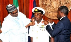 President Muhammadu Buhari (left),  aided by Vice-President Yemi Osinbajo  decorating Chief of Naval  Staff, Ibok Ete Ekwe  Ibas with his new rank of Vice-Admiral, at the Presidential Villa in Abuja,  yesterday