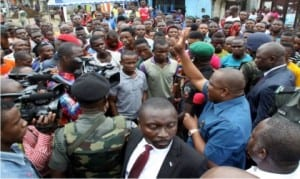 Governor Nyesom Wike of Rivers State (2nd right), addressing protesting bus drivers over the killing of their colleague by a policeman in Port Harcourt recently.