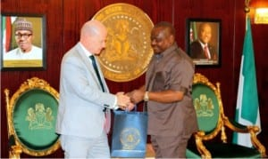 Rivers State Governor, Chief  Nyesom Wike (right), presenting a souvenir to the Ireland Ambassador to Nigeria, Mr. Sein Hoy, during a courtesy call in Government House, Port Harcourt, recently.