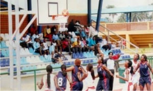Women basketballers in action contesting for victory in a match