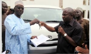 Chief of Staff, Government House,Port Harcourt,  Engr Emeka Woke (right), handing over key of a brand new Toyata Haice bus to the National President,  Sports Writers Association of Nigeria, Seidu Abubakar, during the association's 2015 National Full Council Meeting  in Port Harcourt, yesterday.