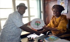 Rivers State Chairman of AUPCTRE, Comrade Henry Urombo, presenting a gift to the Director, Administration, Rivers State Newspaper Corporation, Mrs Emi Jameson, during the inauguration of The Tide Unit Exco in Port Harcourt on Friday.        Photo: Nwiueh Donatus Ken