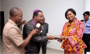 Rivers State Deputy Governor, Dr. Ipalibo Harry Banigo, receiving a bible translated in local languages from National Board member of the Bible Society of Nigeria, Most Rev. Dr. John Fineface, during a courtesy visit to the Deputy Governor in Port Harcourt recently. With them is the 1st Vice Chairman, Mr. Ayotamuno Omoni (left)