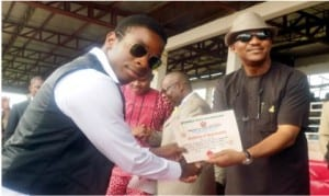 Anambra State Deputy Governor, Dr Nkem Okeke (right), presenting  Certificate of Registration  for Meritorious Youth Service to the representative of the Proprietor of Charity Ezeemo Trust, Mr Sochima Ezeemo in Awka, recently.