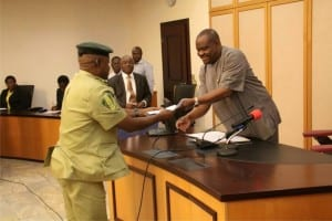 Rivers State Governor, Chief Nyesom  Wike (right), receving a document from the state Comptroller of the Nigeria Immigration Service, Mr Ishaka Haliru,  during a courtesy call on the governor at Government House, Port Harcourt, yesterday.
