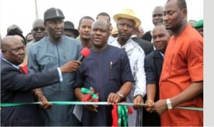 Governor Nyesom Wike of Rivers State (middle), Chairman, Caretaker Committee, Akuku-Toru LGA,  Hon. Odimabo Torukwein (right),former Commissioner for Works, Chief David  Briggs (2nd left) and former Minister of Sports, Hon. Tammy Danagogo (3rd right), during the commissioning of Abonnema/Obonoma Bridge in Abonnema, yesterday. Inset is the bridge